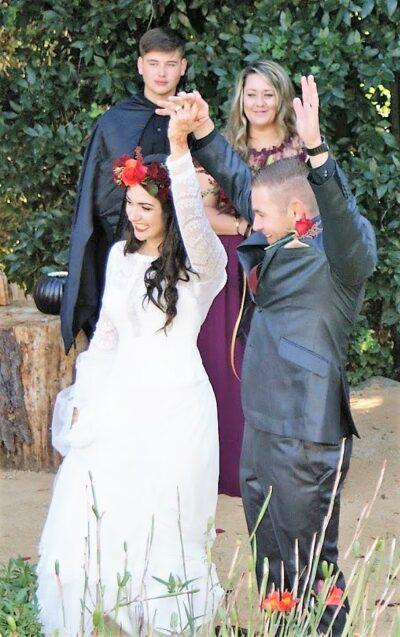 cambria wedding venue - couple at ceremony olallieberry inn gardens