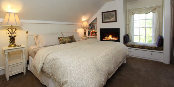 cambria bed and breakfast guest room with bed and fireplace