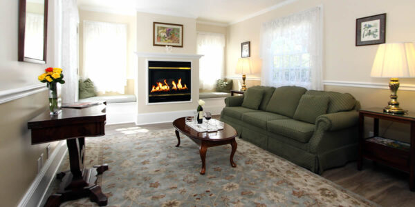 cambria bed and breakfast guest room with couch and fireplace