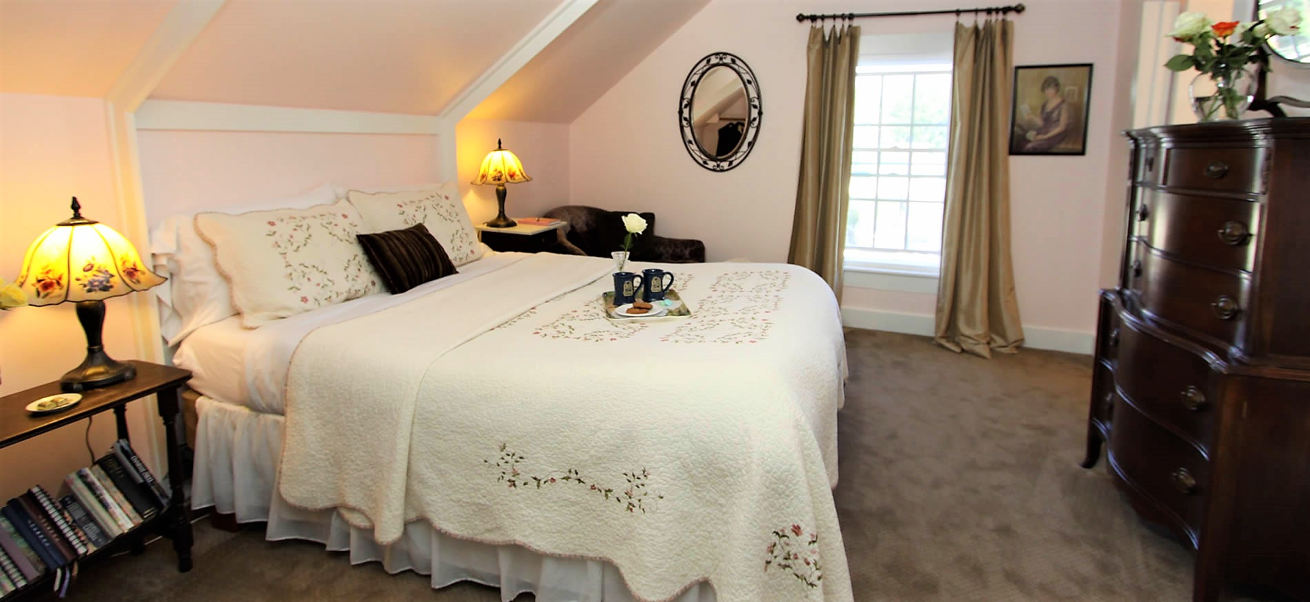 cambria bed and breakfast guestroom with bed and dresser