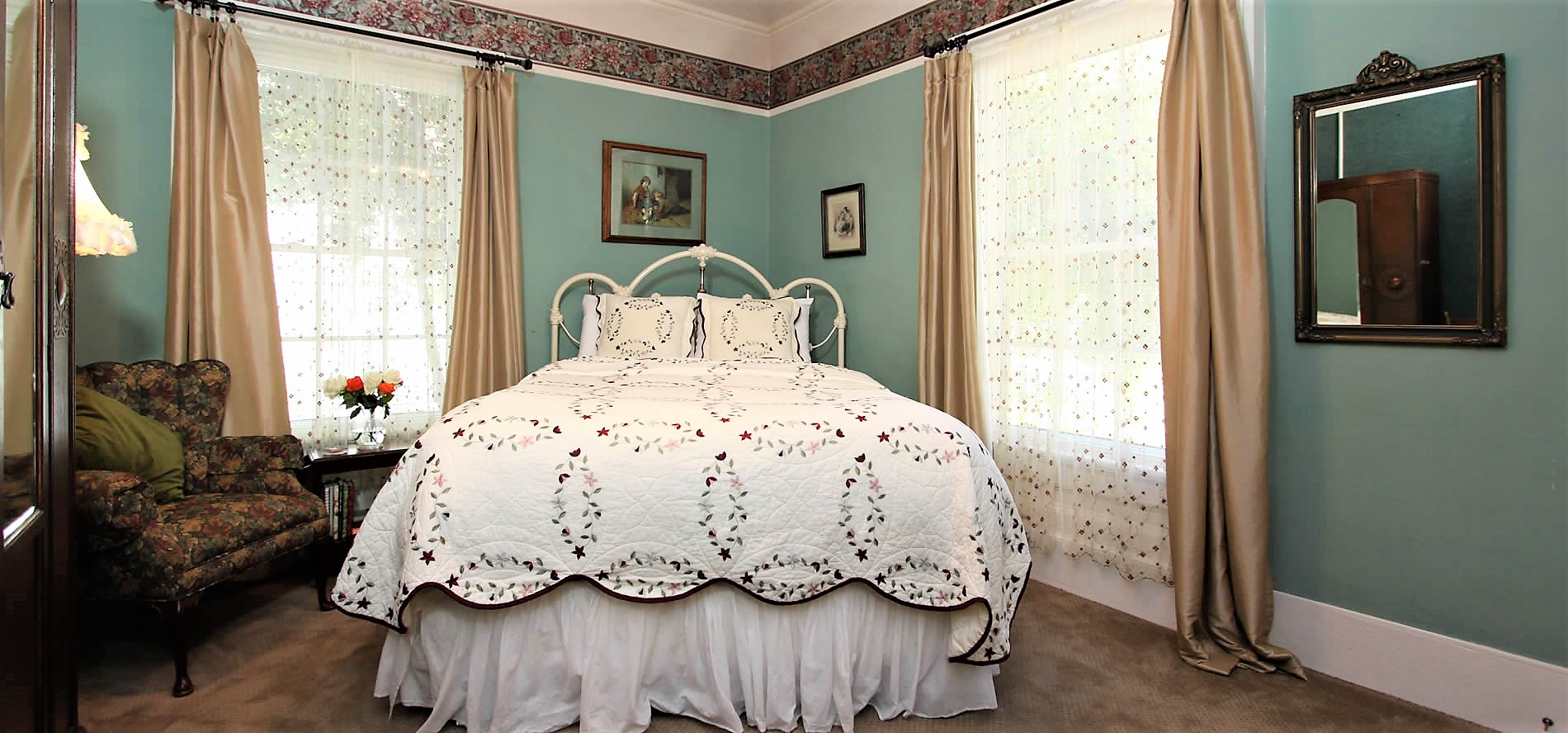 cambria bed and breakfast guestroom with bed and chair
