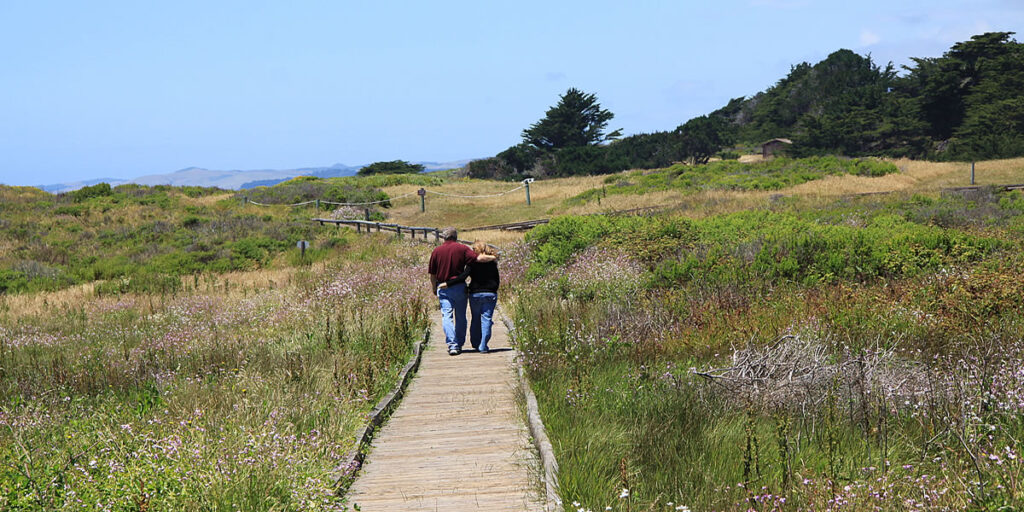 couple walks at moonstone beach