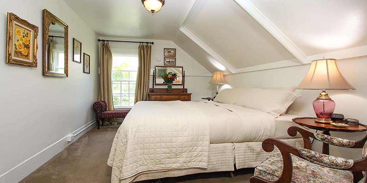 cambria bed and breakfast guest room with bed and chair